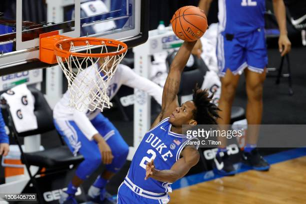 Steward of the Duke Blue Devils dunks the ball during the second half of their second round game against the Louisville Cardinals in the ACC Men's...