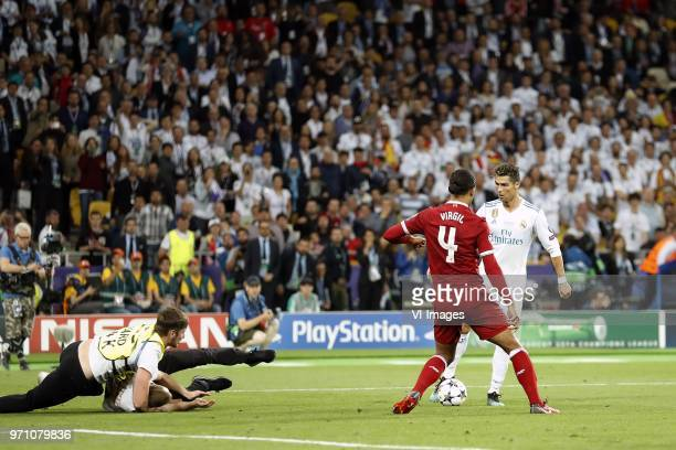 steward pitch intruder Virgil van Dijk of Liverpool FC Cristiano Ronaldo of Real Madrid during the UEFA Champions League final between Real Madrid...