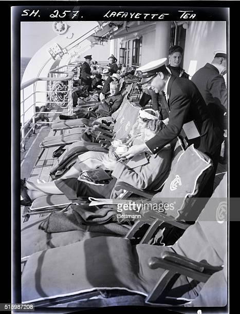 Steward serves tea aboard an ocean liner. Undated photograph.