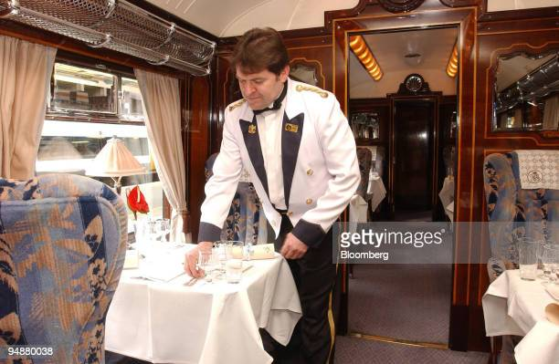 A steward sets a table on the Orient Express prior to departure from Victoria station in central London Thursday May 26 2005