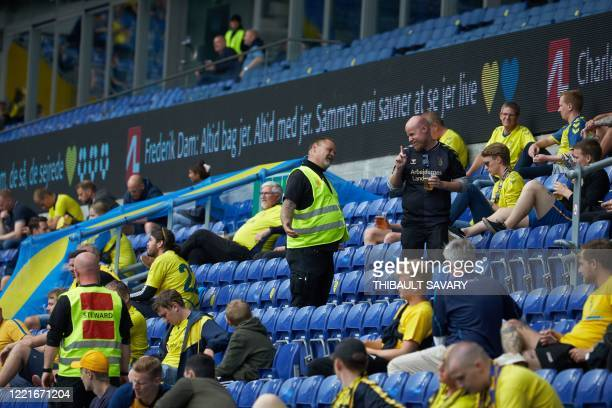 Steward speaks with a Brondby football fan attending a match against FC Copenhagen at Brondby stadium, Denmark on June 21, 2020. - The first tier...