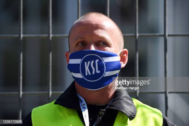 Steward stands in front of a security gate marking zone 3 prior to the Second Bundesliga match between Karlsruher SC and SV Darmstadt 98 at...