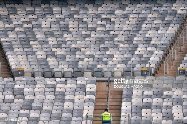 TOPSHOT A steward waits for fans to arrive before the Copa America football tournament group match between Bolivia and Venezuela at the Mineirao...