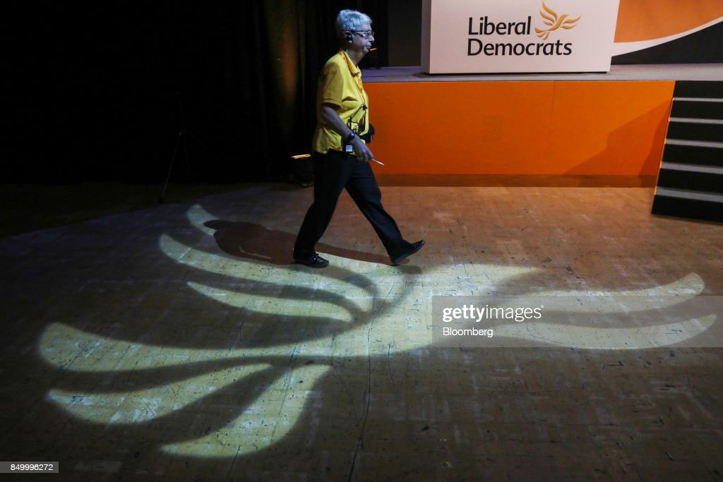 A steward walks through the conference hall during the U.K.'s Liberal Democrat Party annual conference in Bournemouth, U.K., on Tuesday, Sept. 19, 2017. Cable said U.K. Prime Minister Theresa May should fire her foreign secretary, Boris Johnson, over an article he published on Saturday about Britains departure from the European Union. Photographer: Luke MacGregor/Bloomberg via Getty Images
