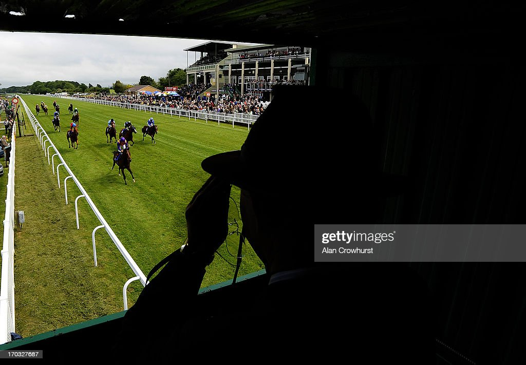 A steward watches the action from his raised position at Salisbury racecourse on June 11, 2013 in Salisbury, England.