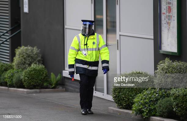 A steward wearing PPE is seen inside The All England Tennis and Croquet Club on June 29 2020 in Wimbledon England The Wimbledon Tennis Championships...