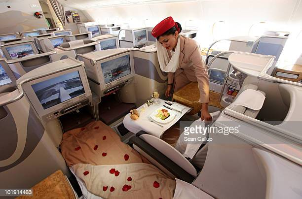 A stewardess adjusts a pillow in the business class section of an Emirates Airbus A380 at the ILA Berlin Air Show on June 9 2010 in Berlin Germany...