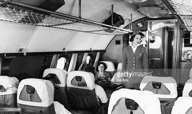 A stewardess and passengers aboard a tu114 airliner 1959