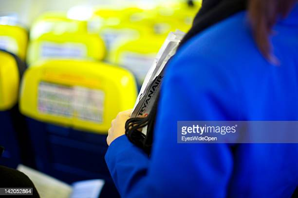 Stewardess at boarding for departure of a RyanAir flight to Alicante Spain at Allgaeu Airport on February 18 2012 in Memmingen Germany