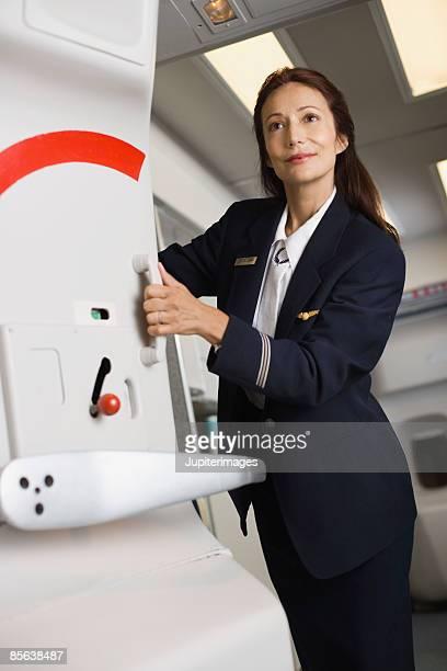 Stewardess closing airplane door