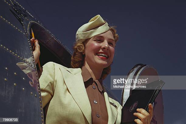 Stewardess exits the plane exits an American Airlines Douglas DC3 at La Guardia Airport in June 1950 in New York City New York