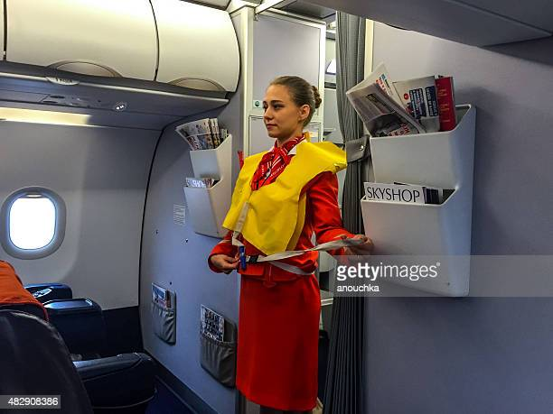 Stewardess giving safety instructions before flight