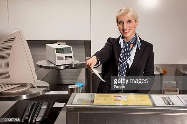 Stewardess handing travel ticket