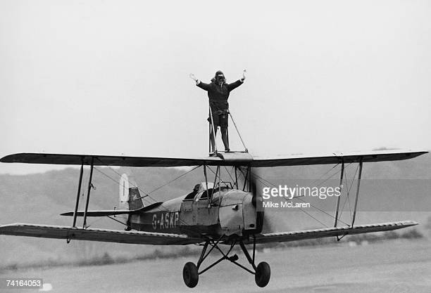 BEA stewardess Jacqui Cheesman rides the wing of a Tiger Moth at Wycombe Air Park Buckinghamshire in preparation for an upcoming flying display at...