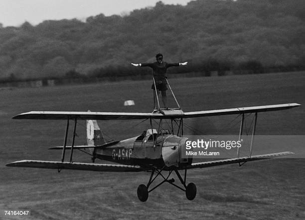 BEA stewardess Moira Boyd rides the wing of a Tiger Moth at Wycombe Air Park Buckinghamshire in preparation for an upcoming flying display at Denham...