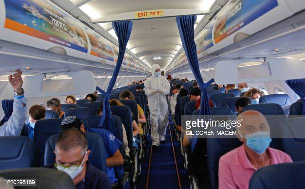 Stewardess of Israir Airlines wearing full PPE prepares for take off from the Ben Gurion International Airport near the central Israeli city of Tel...
