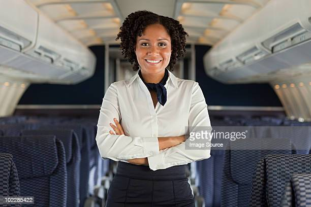 stewardess on airplane - crew stock pictures, royalty-free photos & images