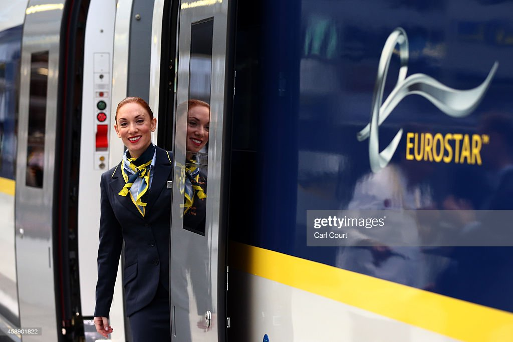 A stewardess poses for photographs on board Eurostar's new e320 train at St Pancras Station on November 13, 2014 in London, England. Launched today, the trains can reach speeds of up to 200mph and will get to Paris 15 minutes quicker than current trains.