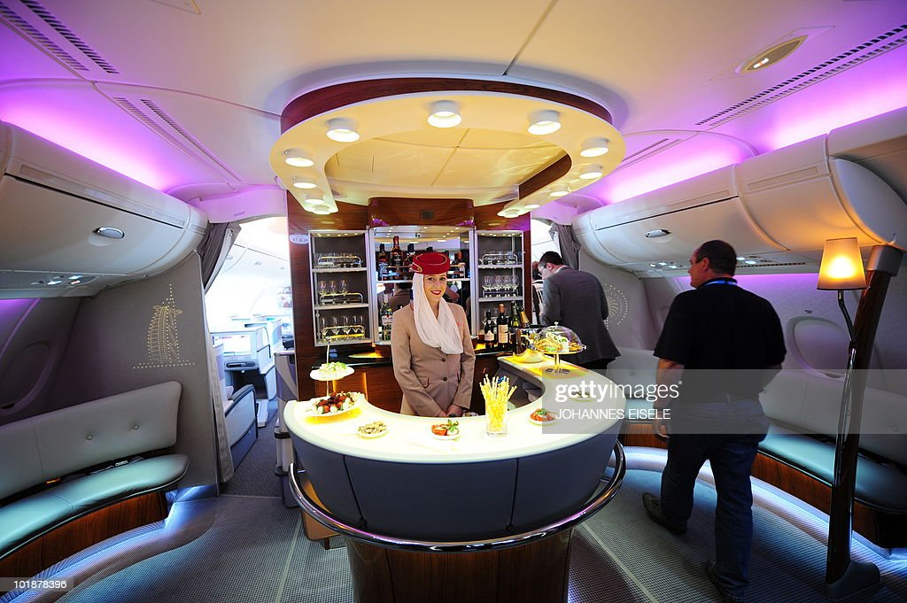 A stewardess poses inside the bar of an : News Photo