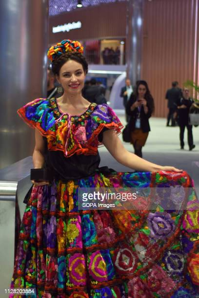 L´HOSPITALET CATALONIA SPAIN A stewardess seen dressed in regional costumes at the Huawei conference stand during the Mobile World Congress 2019 in...
