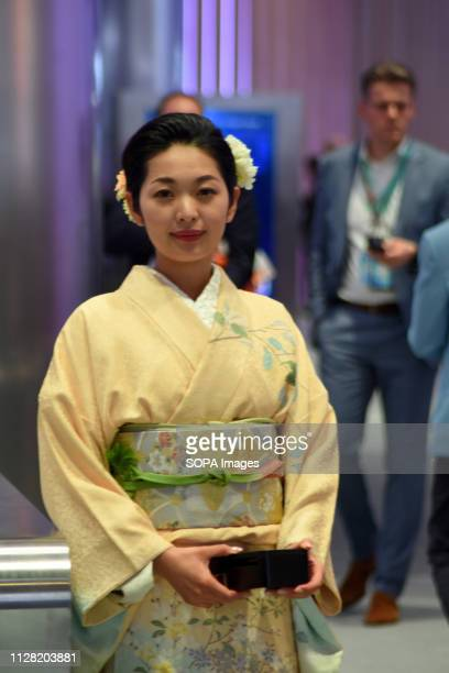 L´HOSPITALET CATALONIA SPAIN A stewardess seen dressed in regional costumes from Japan at the Huawei conference stand during the Mobile World...