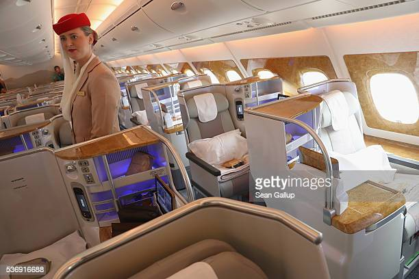 Stewardess waits to welcome visitors in the business class section on board an Emirates A380 passenger plane at the ILA 2016 Berlin Air Show on June...