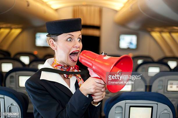 Stewardess with megaphone