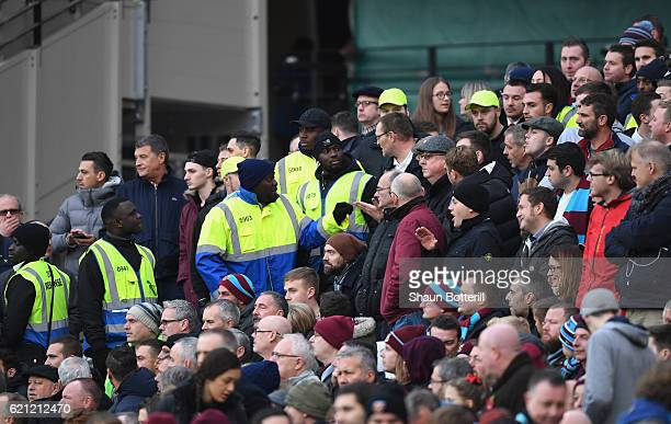 Stewards and fans argue during the Premier League match between West Ham United and Stoke City at Olympic Stadium on November 5 2016 in London England