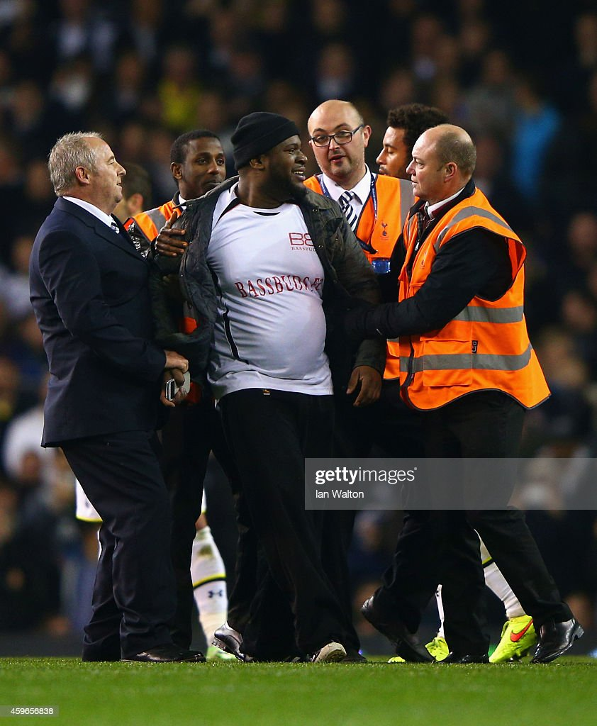 Stewards apprehend a pitch invader during the UEFA Europa League group C match between Tottenham Hotspur FC and FK Partizan at White Hart Lane on November 27, 2014 in London, United Kingdom.