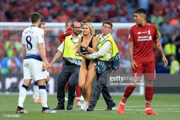 Stewards apprehend a streaker pitch invader during the UEFA Champions League Final between Tottenham Hotspur and Liverpool at Estadio Wanda...