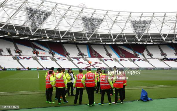 Stewards are seen inside the stadium prior to the Premier League match between West Ham United and Everton at London Stadium on May 13 2018 in London...