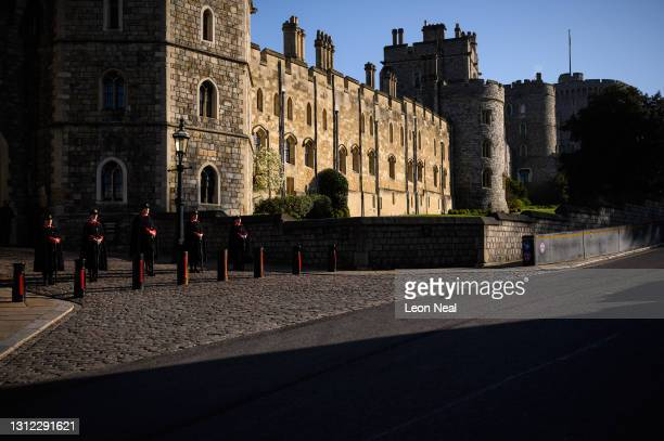 Stewards are seen outside a gate to Windsor Castle as tributes continue to be made to Prince Philip, Duke Of Edinburgh who died at age 99 on April...