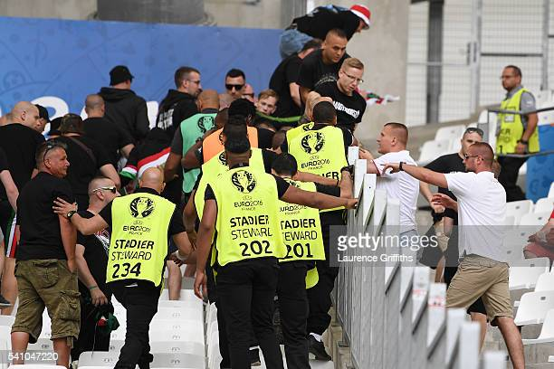 Stewards attempt to control fans during the UEFA EURO 2016 Group F match between Iceland and Hungary at Stade Velodrome on June 18 2016 in Marseille...