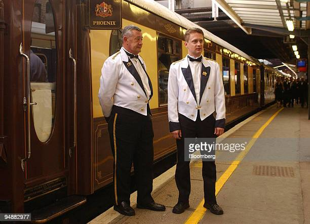 Stewards await diners on the Orient Express prior to departure from Victoria station in central London Thursday May 26 2005