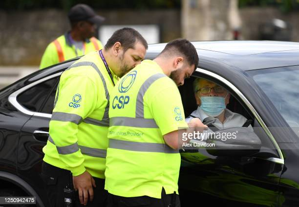 Stewards check temperatures in the car park prior to the Premier League match between Watford FC and Leicester City at Vicarage Road on June 20, 2020...