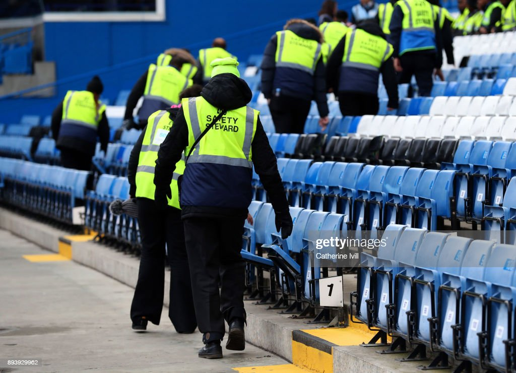 Stewards check the seats during a security check before the Premier League match between Chelsea and Southampton at Stamford Bridge on December 16, 2017 in London, England.