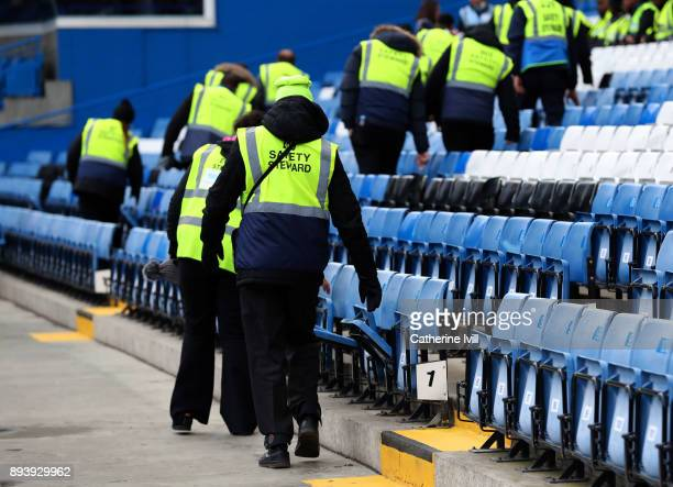 Stewards check the seats during a security check before the Premier League match between Chelsea and Southampton at Stamford Bridge on December 16...