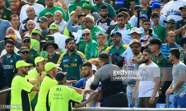 Stewards control spectators during the 2019 Cricket World Cup group stage match between Pakistan and Afghanistan at Headingley in Leeds northern...