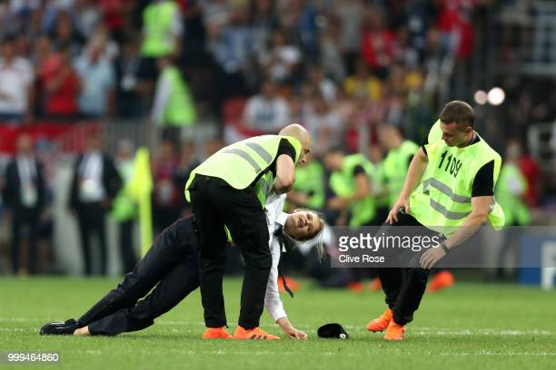 Stewards drag a pitch invader off the pitch during the 2018 FIFA World Cup Final between France and Croatia at Luzhniki Stadium on July 15 2018 in...