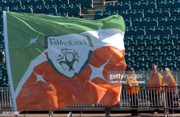 Stewards look at a flag printed with the new Football Association of Ireland logo before the World Cup European Qualifying Group Four match at...