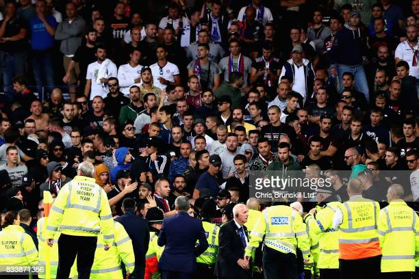 Stewards look on during a crowd disturbance during the UEFA Europa League Qualifying PlayOffs round first leg match between Everton FC and Hajduk...