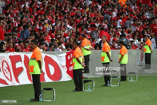 Stewards looks on Internacional fans before match between Internacional and AtleticoPR as part of Brasileirao Series A 2014 in BeiraRio Stadium on...