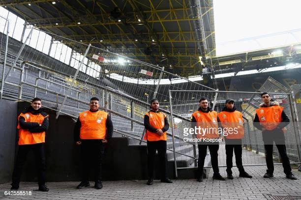 Stewards observe the stadium prior to the Bundesliga match between Borussia Dortmund and VfL Wolfsburg at Signal Iduna Park on February 18 2017 in...