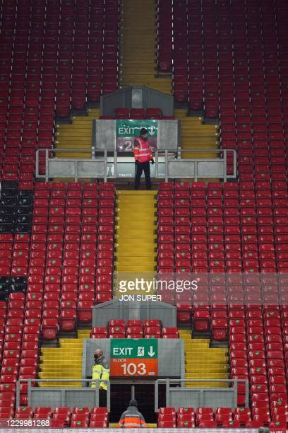 Stewards prepare for the arrival of supporters on The Kop ahead of the English Premier League football match between Liverpool and Wolverhampton...