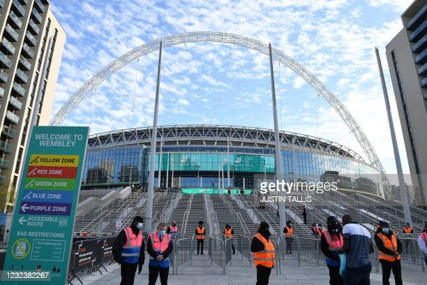 Stewards prepare to welcome spectators to Wembley Stadium ahead of the English FA Cup semi-final football match between Leicester City and...