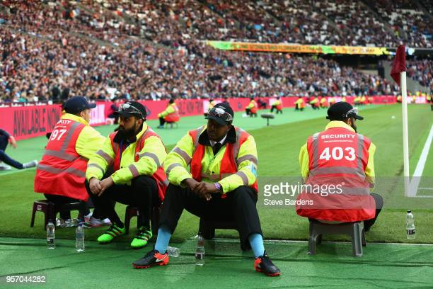 Stewards sit pitch side in case of a pitch invasion during the Premier League match between West Ham United and Manchester United at London Stadium...