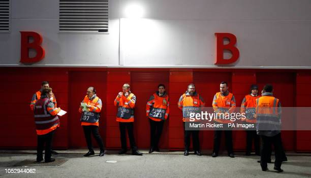 Stewards stand in front of closed turnstiles due to a power cut before the UEFA Champions League Group C match at Anfield Liverpool