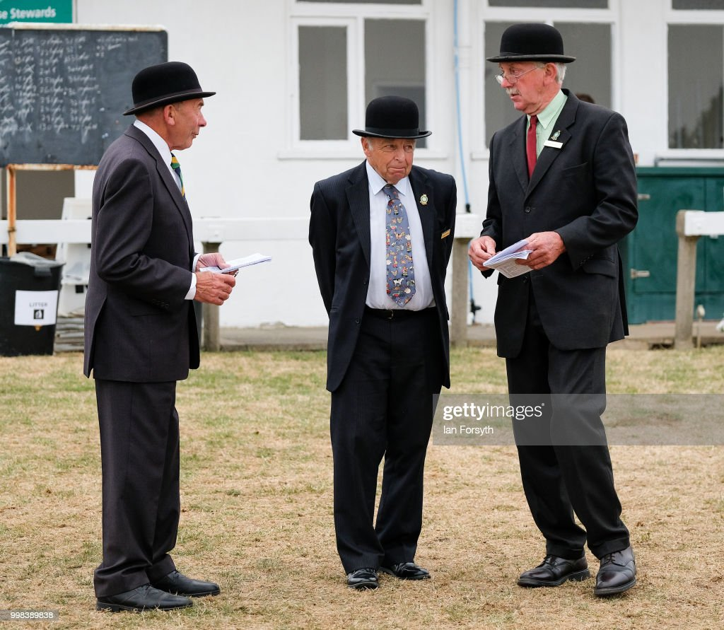 Stewards stand near the main arena during the final day of the 160th Great Yorkshire Show on July 12, 2018 in Harrogate, England. First held in 1838 the show brings together agricultural displays, livestock events, farming demonstrations, food, dairy and produce stands as well as equestrian events. The popular agricultural show is held over three days and celebrates the farming and agricultural community and their way of life.