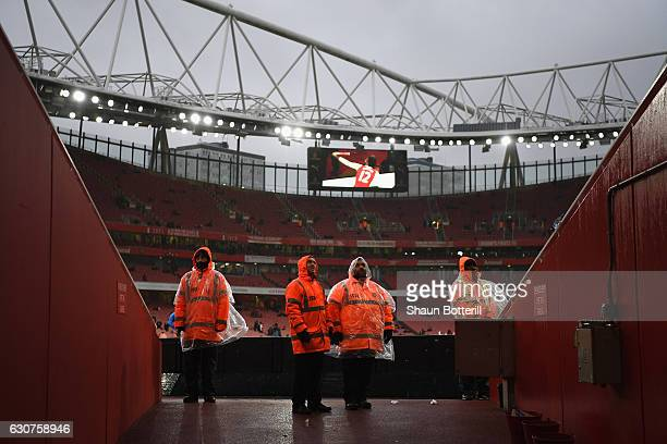 Stewards wait for the fans to arrive before the Premier League match between Arsenal and Crystal Palace at Emirates Stadium on January 1 2017 in...