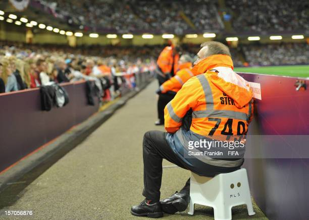 Stewards watch the fans during the Men's Football Quarter Final match between Great Britain and Korea on Day 8 of the London 2012 Olympic Games at...
